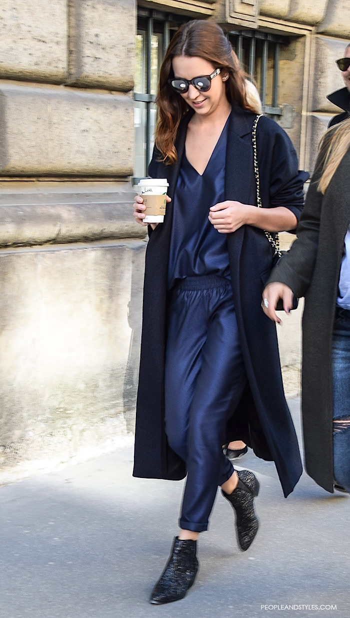 a very fashionable street style look with a navy jumpsuit