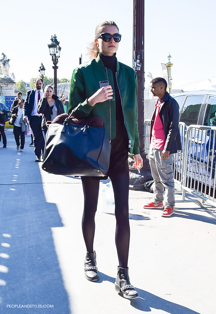 How to wear green bomber jacket, turtleneck, brown mini skirt and biker boots. Model off duty look, street style fashion Paris, what to wear now