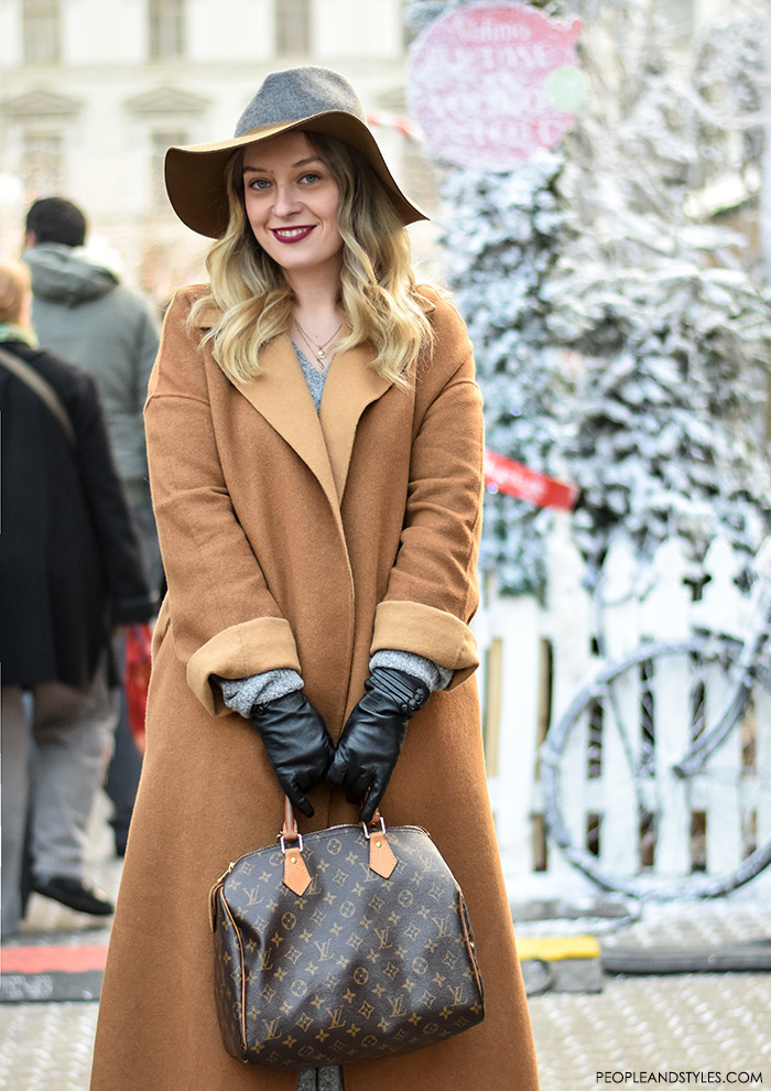 Women's fashion tips: How to wear camel coat and fedora hat. Style with leather gloves, Louis Vuitton designer bag and midi skirt, street style fashion inspiration