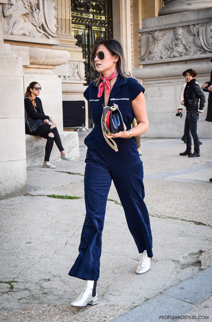How to style red bandana scarf, street style outfit inspiration, how to style bandana with navy jumpsuite and silver ankle boots, Danielle Bernstein in blue velvet overall, red bandana, We Wore What instagram, pinterest