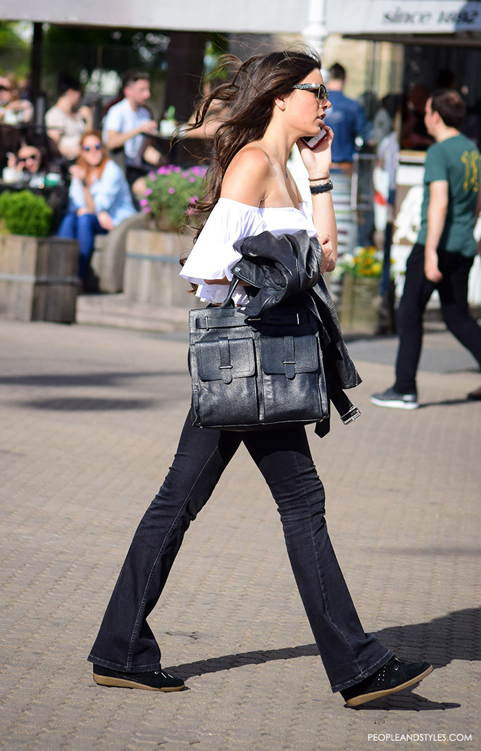 Street style summer women's fashion, how to wear off the shoulder white Zara top, wedge sneakers Isabel Marant and black flared jeans