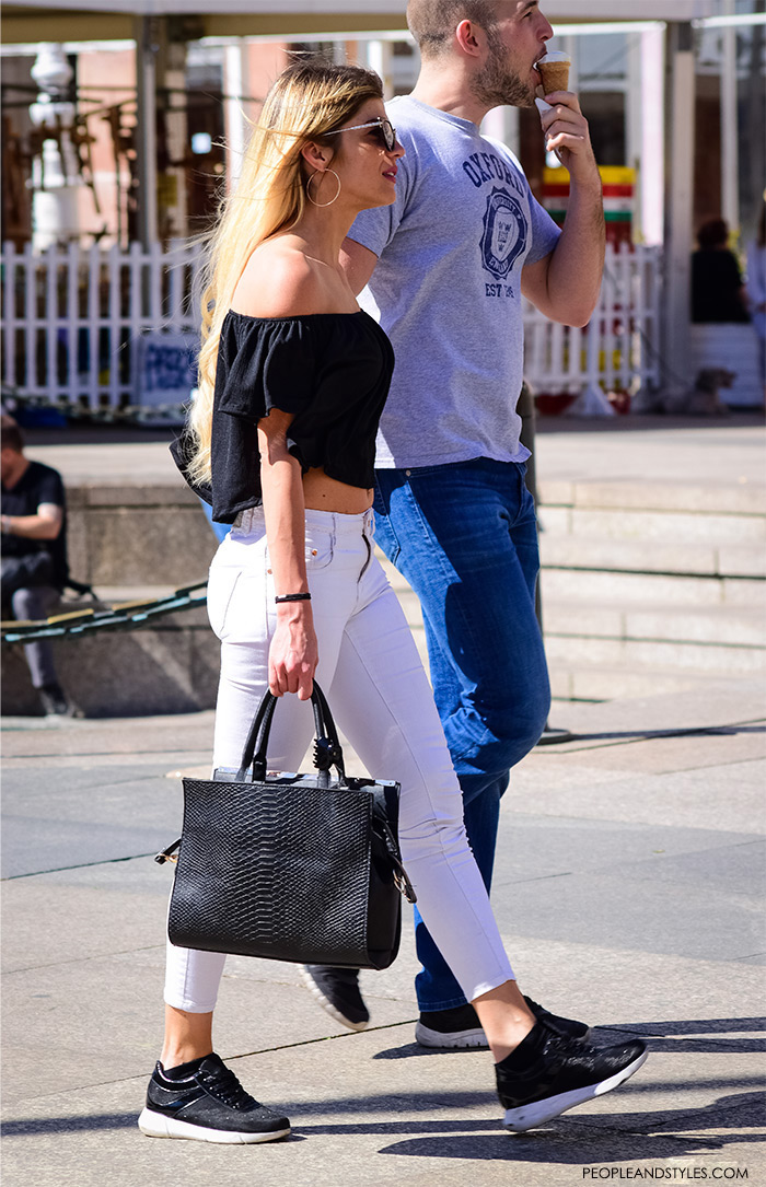 Street style summer women's fashion, how to wear off the shoulder black top, black Nike sneakers and white jeans