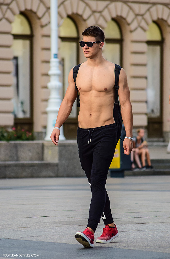 a guy wearing casual summet street fashion outfit shirless guy with joggers  and red Nike sneakers e834284bb