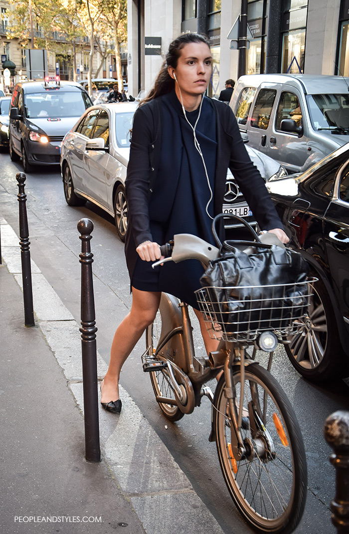 Paris street wear fashion Women's Fashion: How to wear a navy dress, navy cardigan and ballet shoes, street style fashion, women on a bike in Paris, Paris Fashion Week elegant look