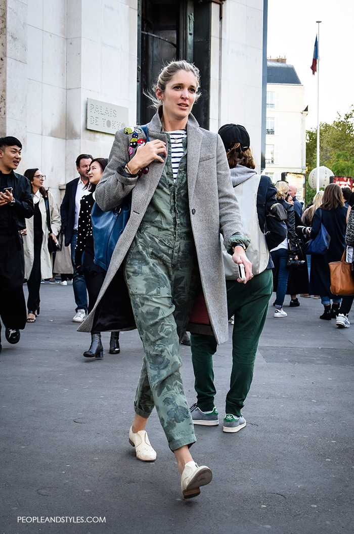 9to5 smart: Jumpsuit and Striped Shirt, green camo jumpsuites, street style women's fashion styling tips what to wear with jumpsuit, grey coat white flat shoes wear to work